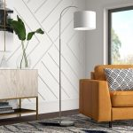 floor lamp standing near armchair