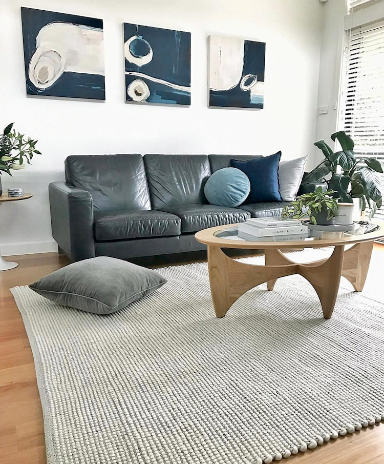 flatweave rug for living room with modern grey sofas, coffee table and black pillows
