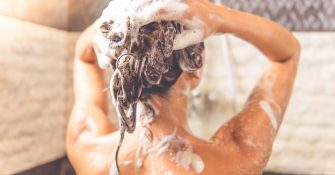 woman-shampooing-hair-in-shower