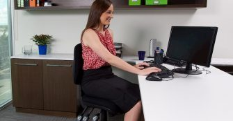woman sitting on an ergonomic office chair