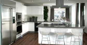 modern kitchen with white and metal elements and vinyl flooring