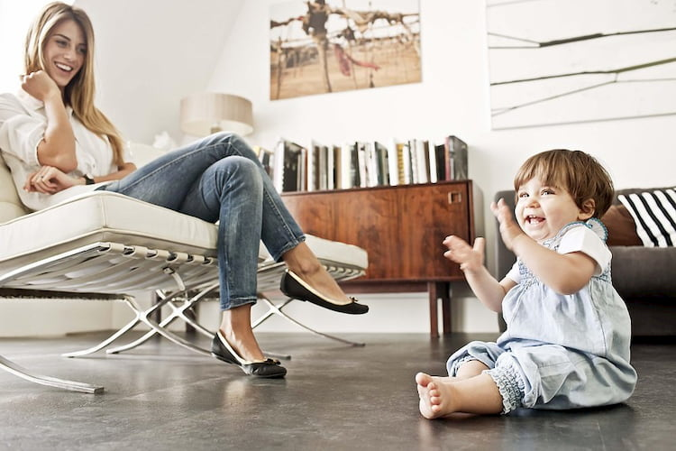 women sitting on a chair and little girl sitting on the floor