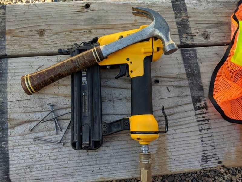 Close up picture of hammer and nail gun