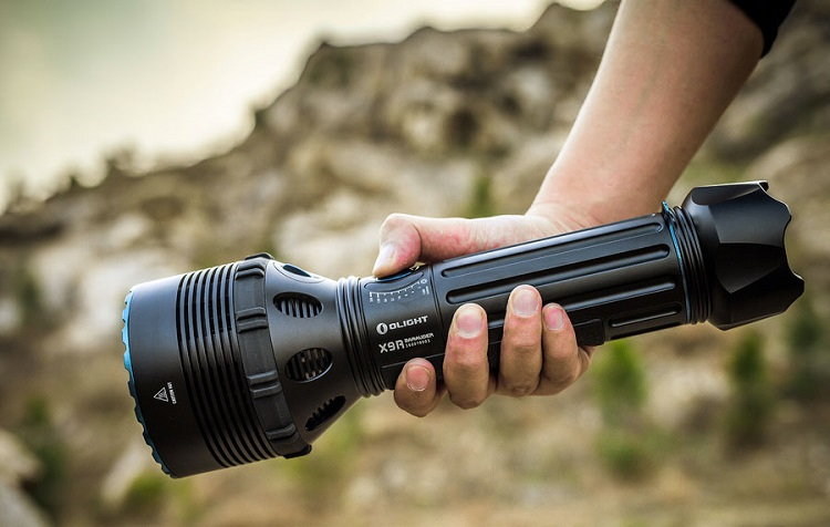picture of a person holding X9R Marauder flashlight in the wild