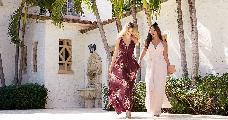 Two women in stylish maxi dresses